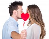 stock photo of kiss  - Beautiful couple in love kissing isolated on white background - JPG