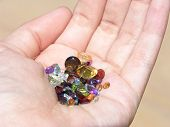 stock photo of marquise  - Hand holding about 70 carats of mixed faceted gemstones - JPG