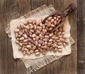image of pinto bean  - Pinto beans with a spoon on a wooden table - JPG