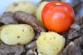 picture of liver fry  - Fried pork liver with tomatoes and potatoes