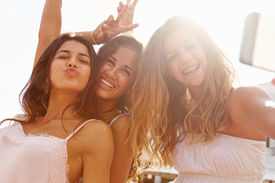 picture of selfie  - Three Teenage Girls Dancing And Taking Selfie - JPG