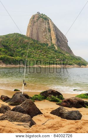 Mountain Sugarloaf And Fishing Rod On Red Beach In Rainy Day, Rio De Janeiro, Brazil