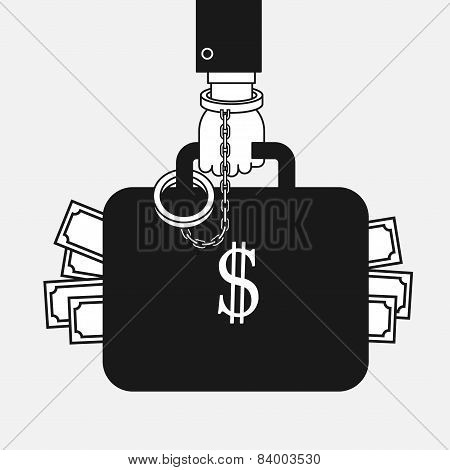 suitcase with american dollars handcuffed to a businessman hand