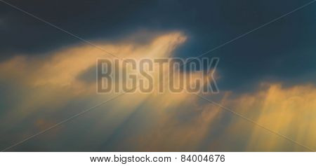 ray of light through dark cloud