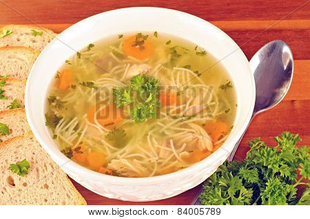 Bowl With Chicken Soup With Vegetables And Chicken Meat, Toasted Bread