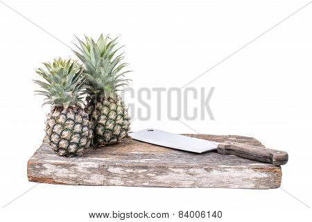 Chopping Block And Cleaver With Pineapple Isolated On White Background