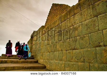 Unidentified tourists visiting Ingapirca important inca ruins in Ecuador