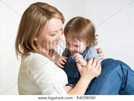 Mother playing with child.  Maternity happiness.
