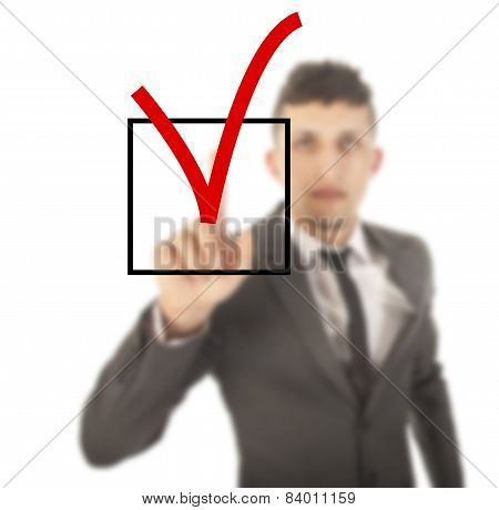 Young Businessman With Checkbox Isolated On White Background
