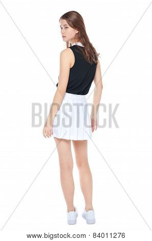 Young Fashion Girl In White Skirt Posing Isolated. Back