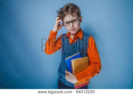 boy teenager European appearance in retro clothes with books in