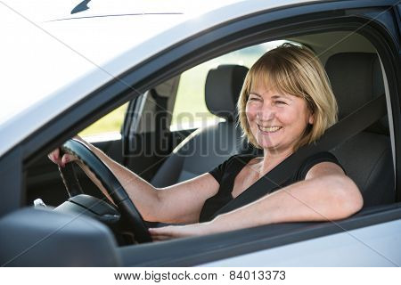 Mature woman driving car