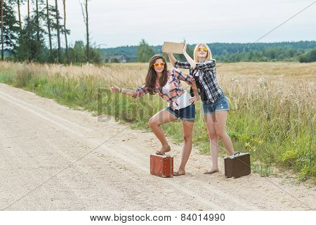 Happy Students Hitchhike With Cardboard On Road