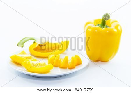 Sliced Sweet Yellow Capsicum Ingredient On White Plate