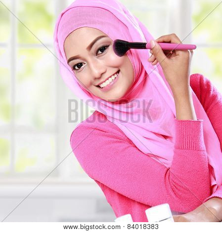 Young Woman Wearing Hijab Applying Blush On