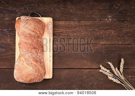 Fresh bread on wooden cutted board