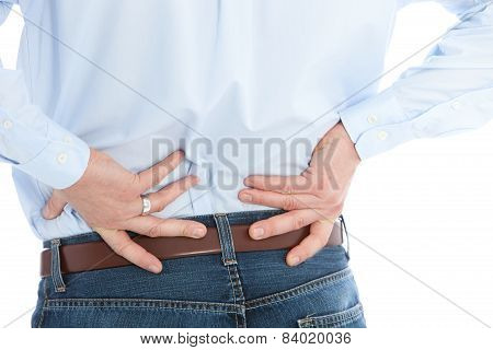 Man Holding His Back While Suffering From Back Pain