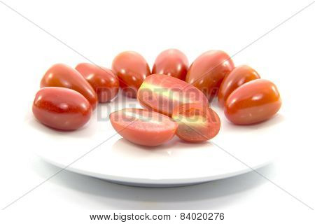 Mini Tomato Sliced And Raw Material On White Plate