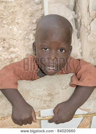 Thiaroye, Senegal, Africa - August 2, 2014: Unidentified little boy standing in the street