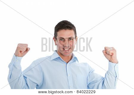 Successful Man Holding Arms Up In Clenched Fists