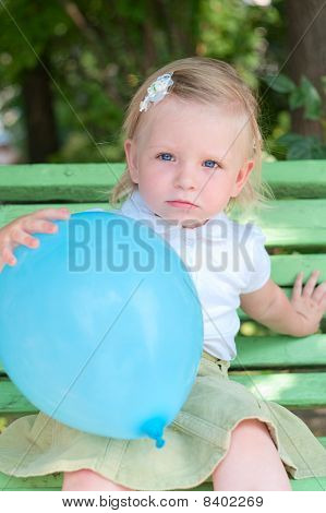 Little Girl With Blue Air Balloon