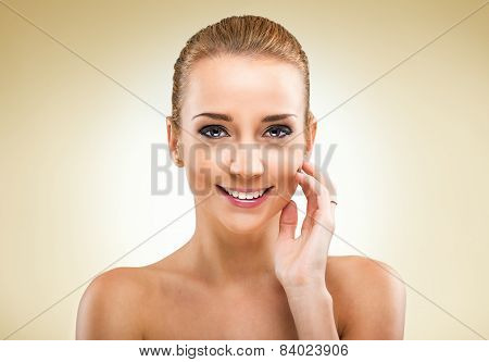 Beautiful blonde woman looking camera - light background
