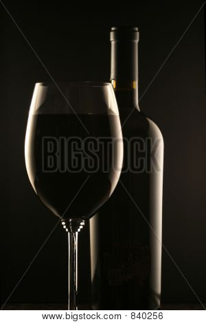 Glass of Wine and Wine Bottle