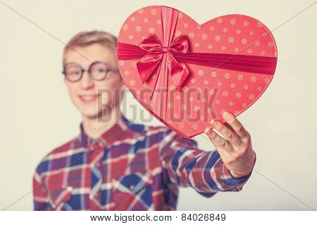 Nerd Teen Guy With Red Heart Shape Gift.