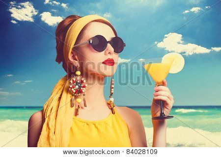 Pretty Redhead Women With Cocktail On The Beach.