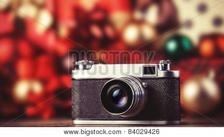Retro Camera On Holidays Background.