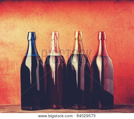 Four Different Bottles With Young Wine.