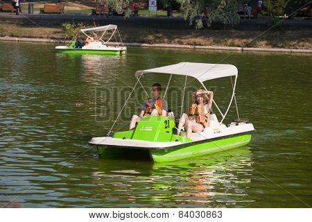 A Guy And A Girl Riding A Catamaran