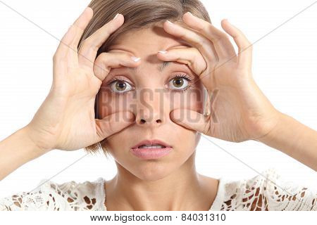 Tired Woman Opening Her Eyes With The Fingers