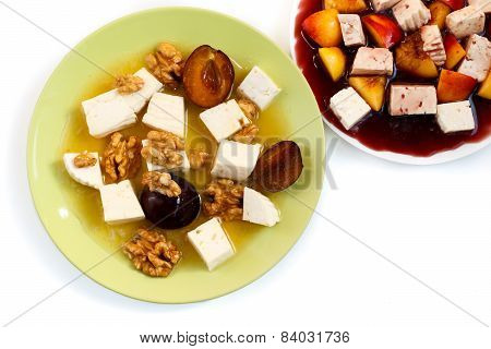 sweet fruity salads with cheese isolated on white