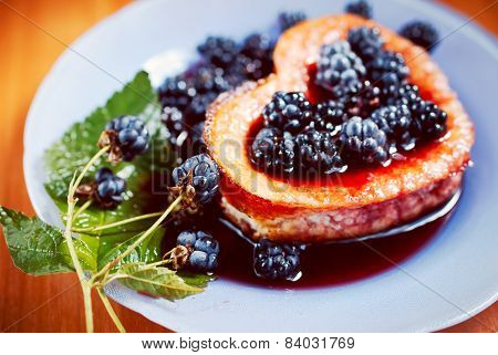 Heart-shaped sweet berry omelet with blackberry, back side