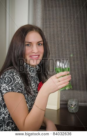 Young Beautiful Woman Drinks A Cocktail