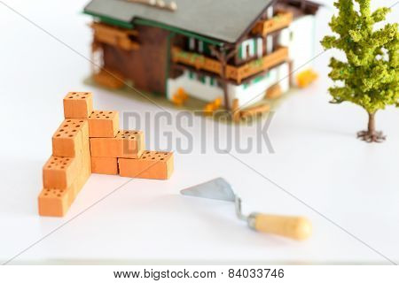 Wall With Bricks And House