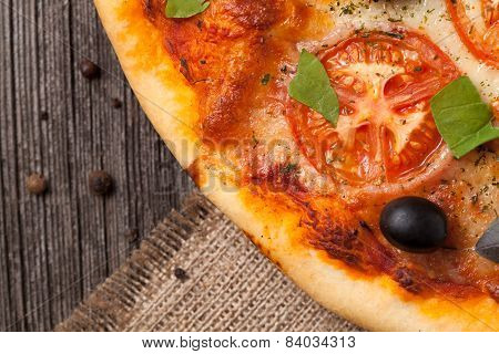 Italian Pizza Margherita With Tomatoes, Olive Oil And Basil Close Up