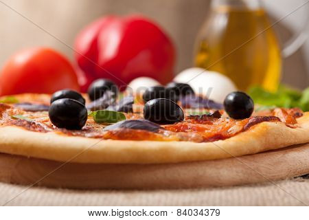 Pizza Margherita With Tomatoes, Olives And Basil On Vintage Rustic Background Close Up