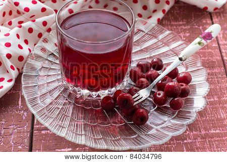 Cherry compote with berries