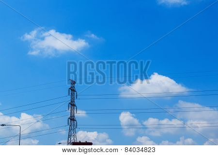 High Voltage Pole With  Sky  Clouds