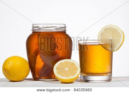 Kombucha Super Food Pro Biotic Beverage In Glass With Lemon On White Background