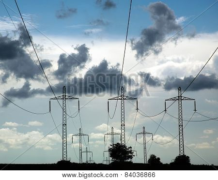 Pillars Of Line Power Electricity On Background Blue Sky And Clouds