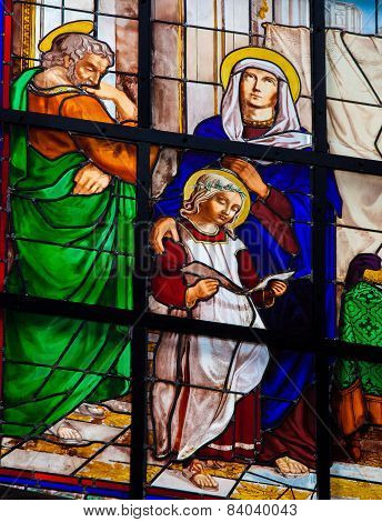 Stained Glass Window Of The Child Jesus And Mary And Joseph
