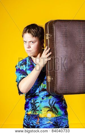 Affective Teenage Boy With Retro Suitcase