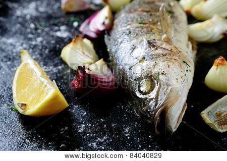 Roasted Sea Bass On A Dark Sheet