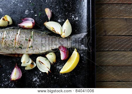 Baked Fish With Lemon And Onion On A Tray