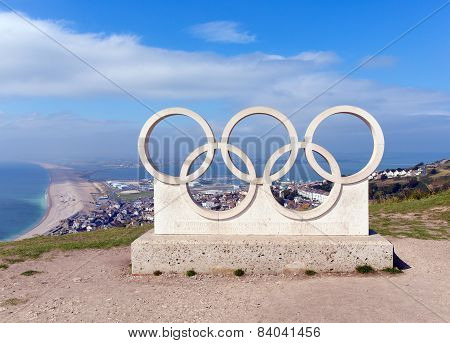 Sunny summer weather enticed visitors to enjoy the view of Chesil beach from the Olympic Rings