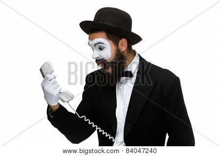 angry and irritated  man screams into the telephone receiver