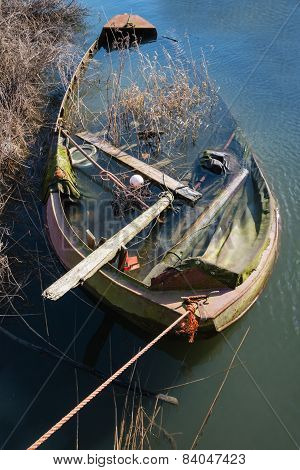Half Sunken Neglected Steel Rowboat
